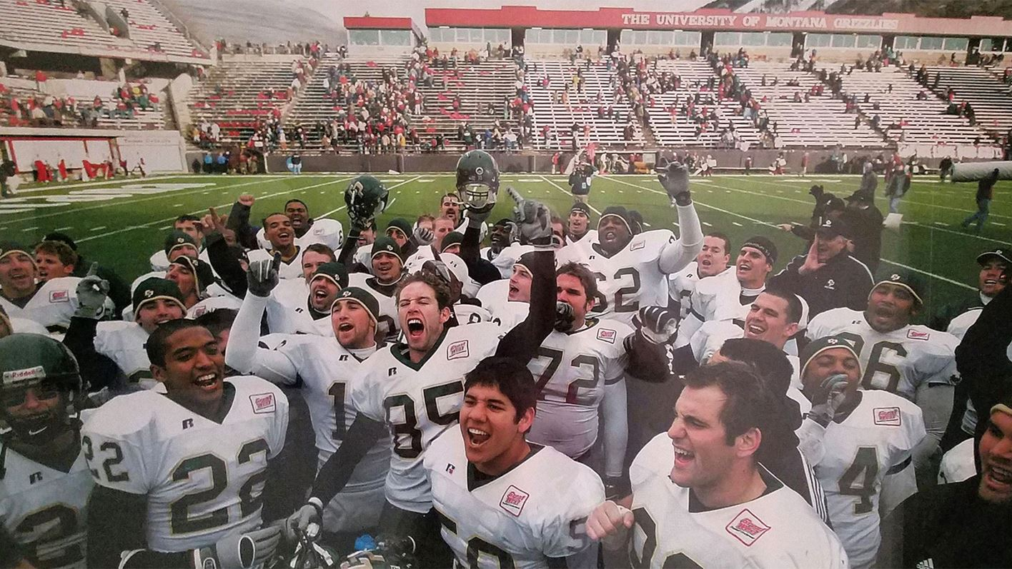 Cal Poly players celebrate playoff win at Montana in 2005.